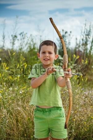 Boy shoots a bow Stock photo © grafvision