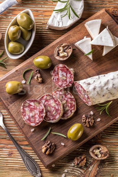 Szalámi rusztikus tányér olajbogyó camembert hús Stock fotó © grafvision