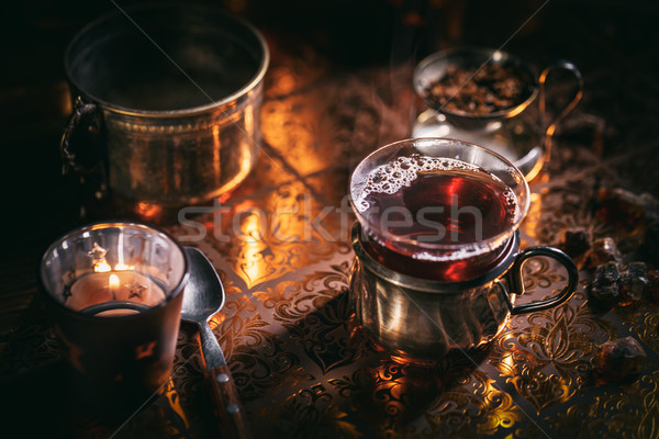 Black tea in a glass cup at candle light Stock photo © grafvision