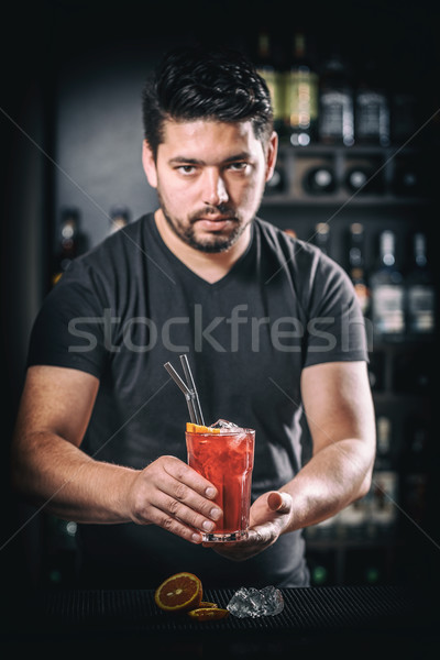Stock photo: Barman is serving cocktail