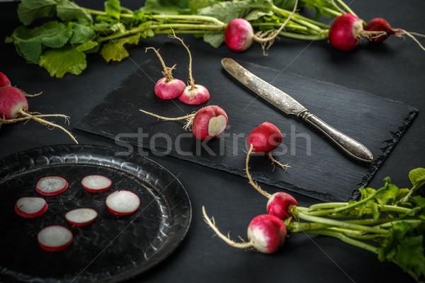 Friss retek fekete háttér piros zöldség Stock fotó © grafvision