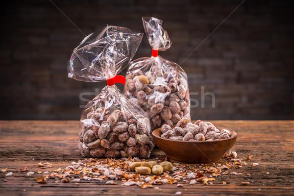 Gezouten pinda's houten kom noten Stockfoto © grafvision