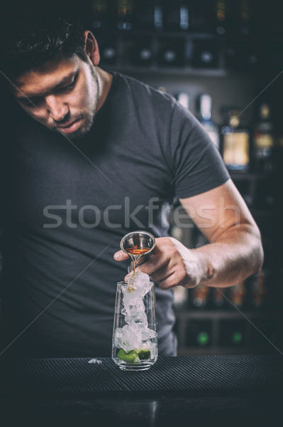Stock photo: Barman prepares a cocktail