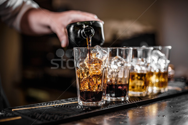 Bartender pouring alcoholic drink Stock photo © grafvision