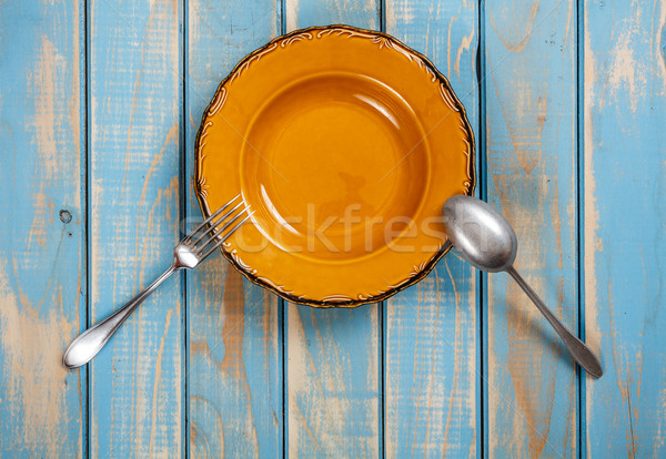 Brown dinner set on painted wooden board Stock photo © grafvision