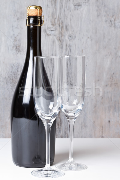 Stock photo: Champagne glasses with bottle