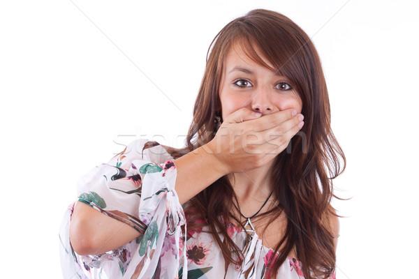 Nő befogja száját meglepődött fiatal nő kéz másfelé néz Stock fotó © grafvision
