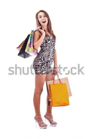 Vásárlás teljes alakos boldog fiatal nő tart bevásárlótáskák Stock fotó © grafvision