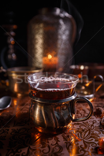 Black tea in cup and candles  Stock photo © grafvision