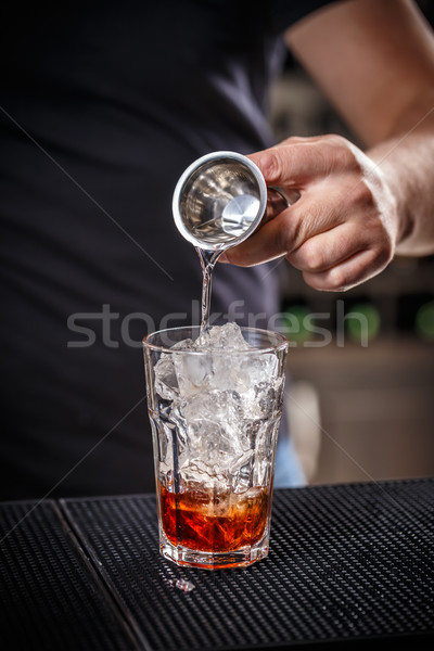 Barman is pouring alcohol Stock photo © grafvision