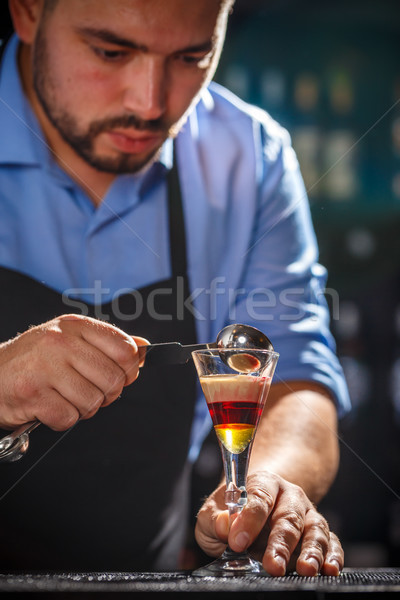 Bartender preparing layered cocktail Stock photo © grafvision