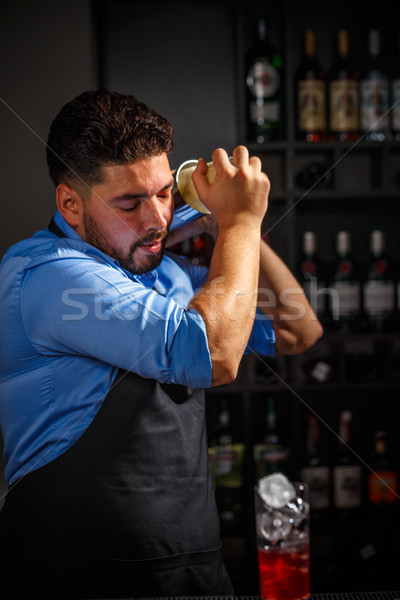 Bartender shakes and mixing alcohol Stock photo © grafvision