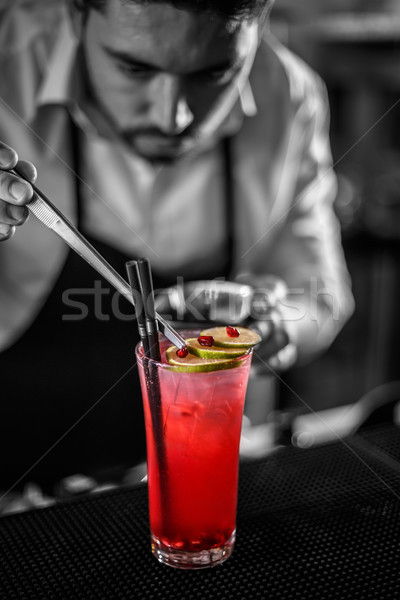 Bartender decorating non-alcoholic pomegranate cocktail Stock photo © grafvision
