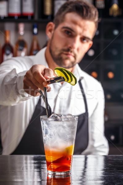 Stock photo: Barman decorating cocktail