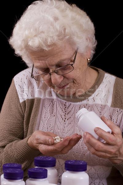 Kıdemli kadın çok hapları yalıtılmış Stok fotoğraf © grafvision