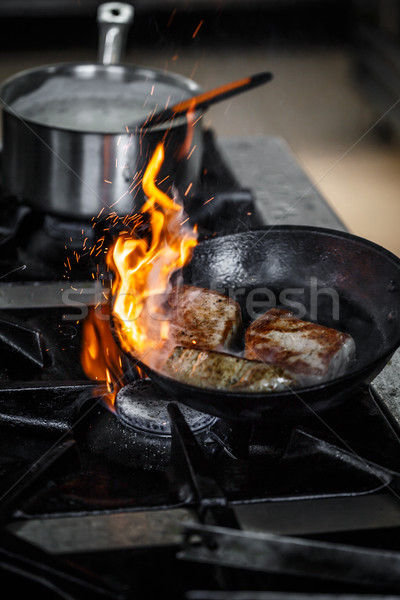 Chef frying pork meat Stock photo © grafvision