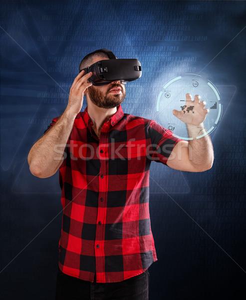 Man using VR glasses Stock photo © grafvision