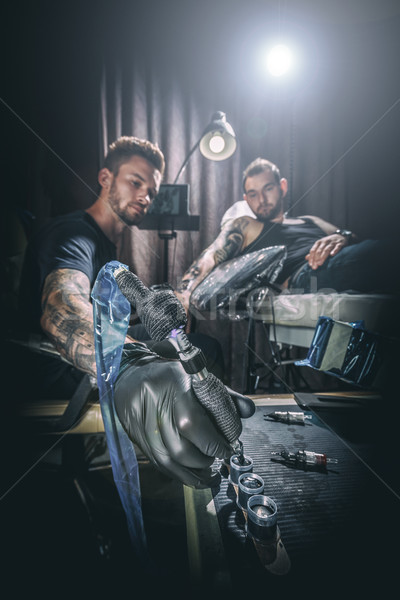 Man tattoo master Stock photo © grafvision