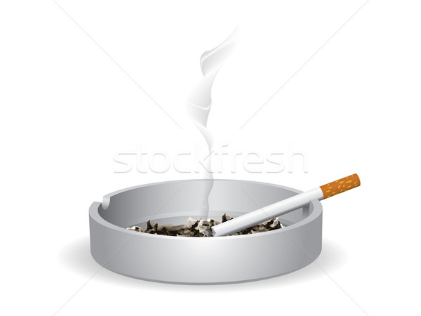 Cigarette lighted is on the ashtray Stock photo © graphit