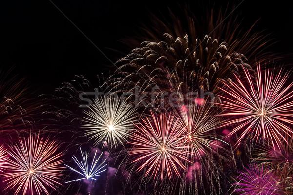 Többszörös tűzijáték fekete égbolt füst zöld Stock fotó © grasycho