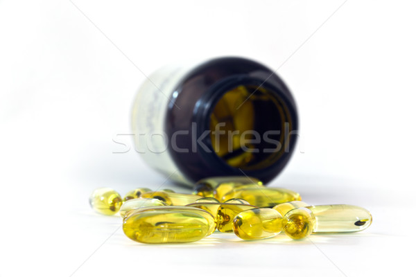 Yellow Fish Oils Isolated on White Background Stock photo © grasycho
