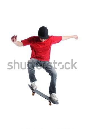 скейтбордист прыжки изолированный белый спорт Skate Сток-фото © gravityimaging
