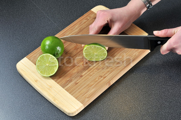 Slicing lime on a table  Stock photo © gravityimaging
