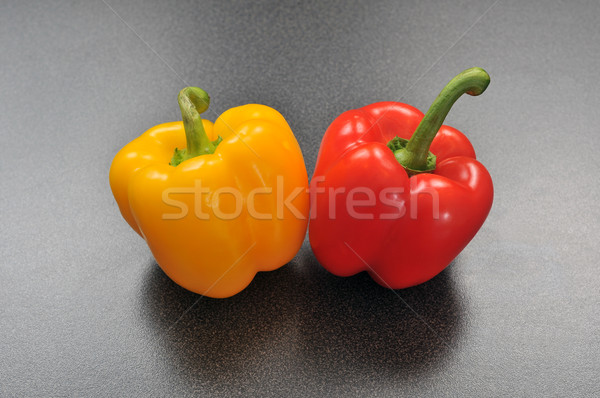 Yellow and red pepper on a modern table top  Stock photo © gravityimaging