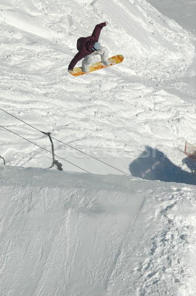 прыжки высокий гор снега сноуборд Сток-фото © gravityimaging