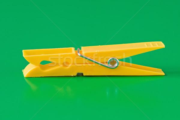 Amarelo plástico prendedor de roupa verde isolado abstrato Foto stock © Grazvydas