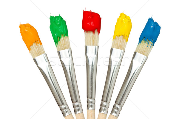Five paintbrushes with color paints Stock photo © Grazvydas