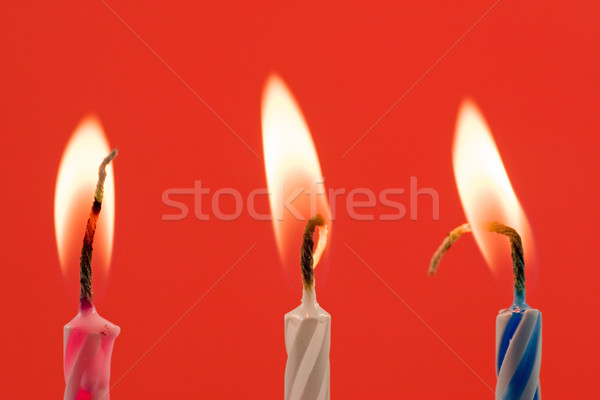 Stock photo: birthday candles on a red background