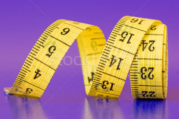 close-up of a yellow measure tape Stock photo © Grazvydas