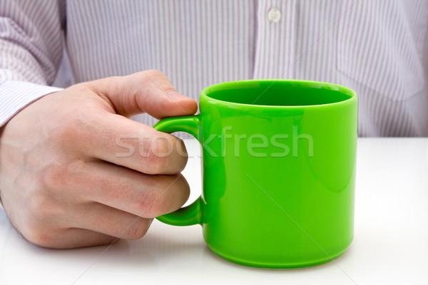 Imprenditore tenere verde Cup tè Foto d'archivio © Grazvydas