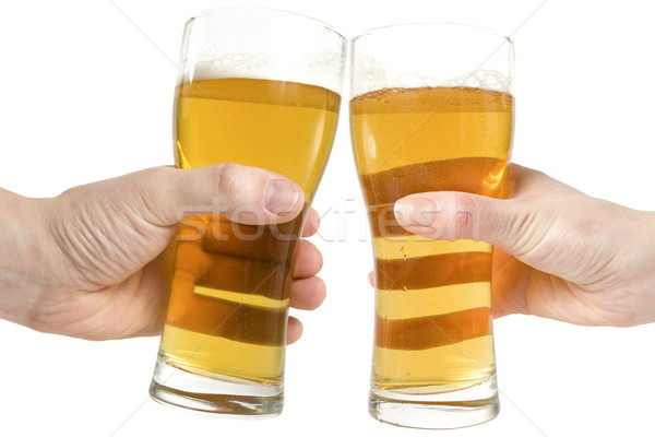 two hands holding beers making a toast  Stock photo © Grazvydas