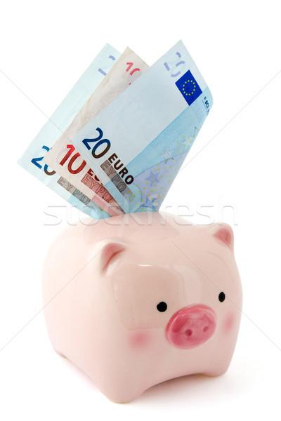 Piggy bank with Euro bills Stock photo © Grazvydas
