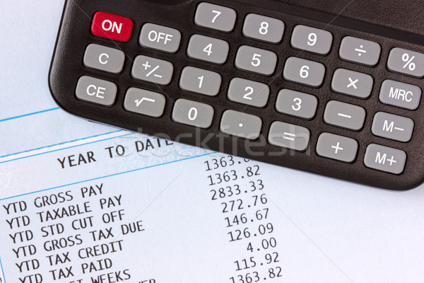 Calculator and payroll  Stock photo © Grazvydas