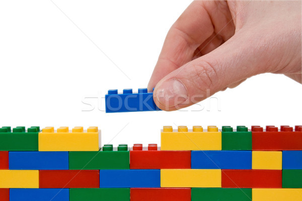 Main bâtiment lego up mur construction Photo stock © Grazvydas