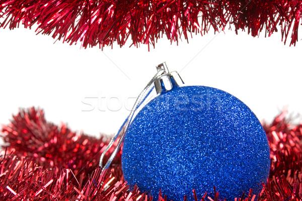 Christmas tinsel and blue bauble Stock photo © Grazvydas