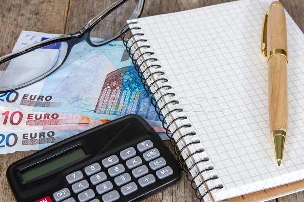 Pénzügyi tervezés számológép pénz szemüveg notebook toll Stock fotó © Grazvydas
