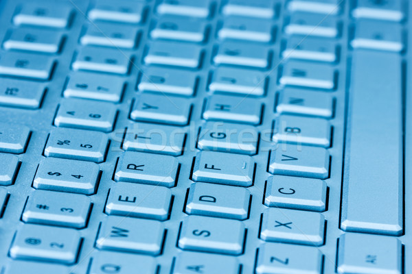 Computer keyboard in blue light Stock photo © Grazvydas