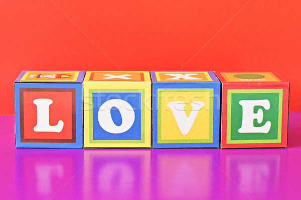 word 'love' spelled out in baby blocks Stock photo © Grazvydas