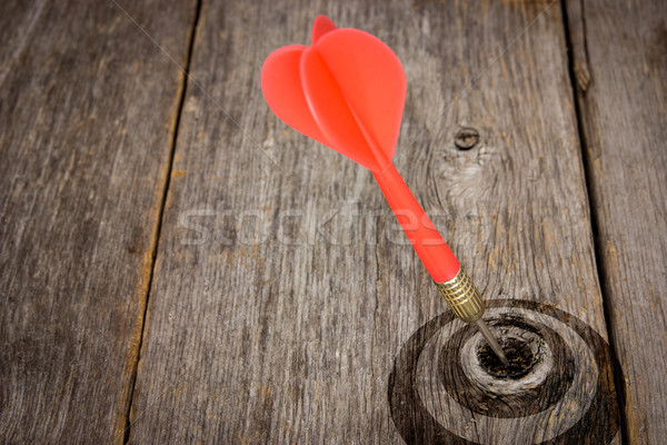 Dart hitting target on a wooden planks Stock photo © Grazvydas