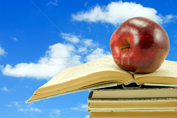 books with apple on sky background Stock photo © Grazvydas