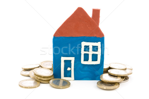 house and coins over a white background Stock photo © Grazvydas