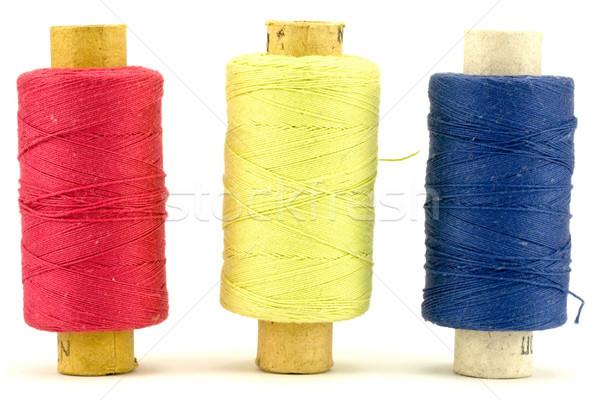 Três fio colorido de costura algodão roupa Foto stock © Grazvydas