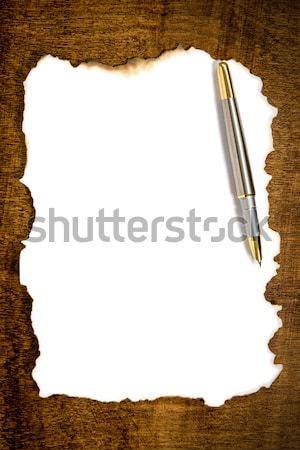 Burnt paper with pen  Stock photo © Grazvydas