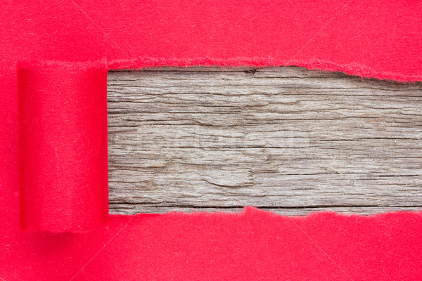 Red paper torn to reveal wooden panel Stock photo © Grazvydas