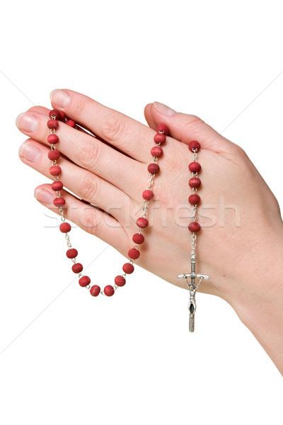 Vrouwelijke handen rozenkrans geïsoleerd witte jesus Stockfoto © Grazvydas