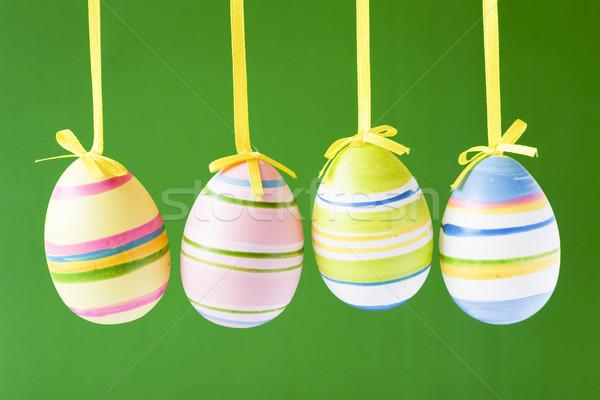 four hung easter eggs Stock photo © Grazvydas